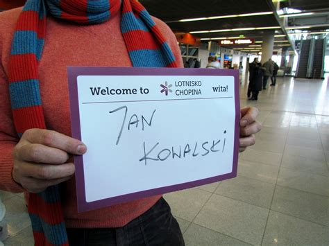 Welcome boards at Warsaw's Chopin Airport - Stuck at the